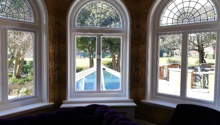 Bay window in the hotel bar & lounge area overlooking garden